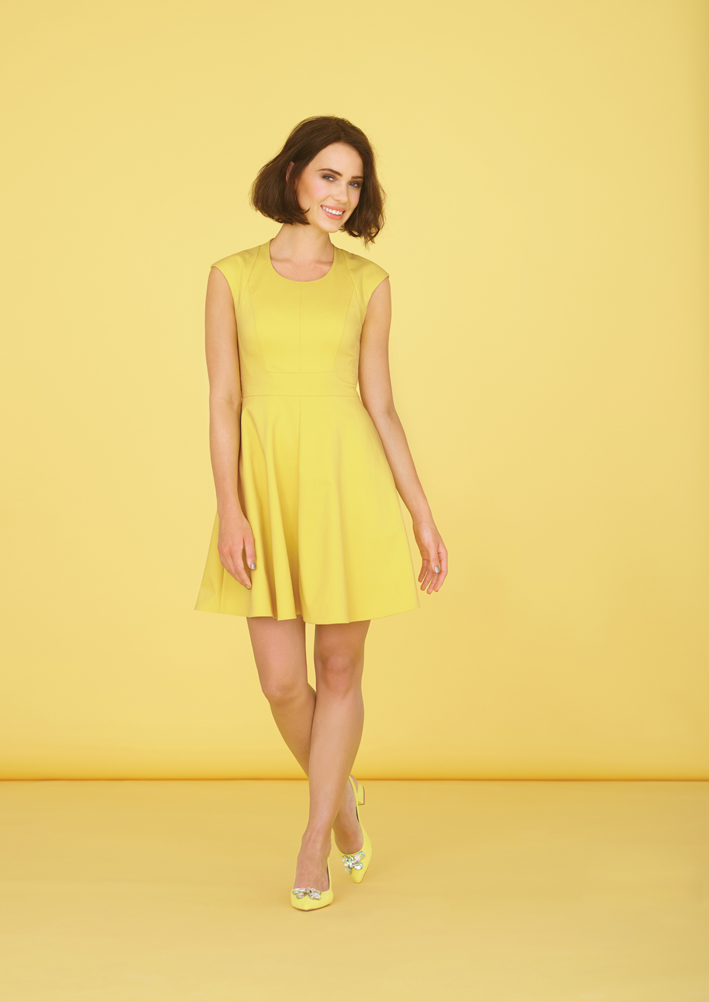 Woman in yellow sun dress with gorgeous bob